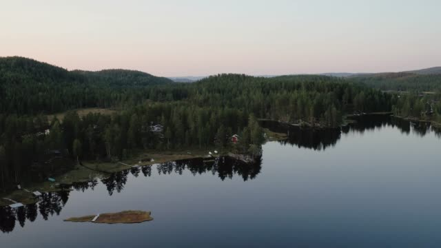 Drone shot of cabins in the Norwegian woods