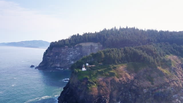 drone shot of cape meares state scenic viewpoint - oregon coast stock videos & royalty-free footage