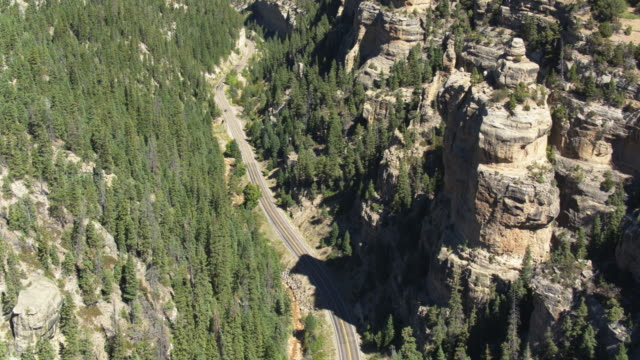 drone shot of cars on quiet highway 14 through cedar canyon, utah - extreme terrain stock videos & royalty-free footage