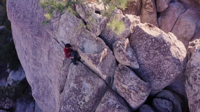 drone shot of climber attaching rope to slcd - angeles national forest stock videos and b-roll footage