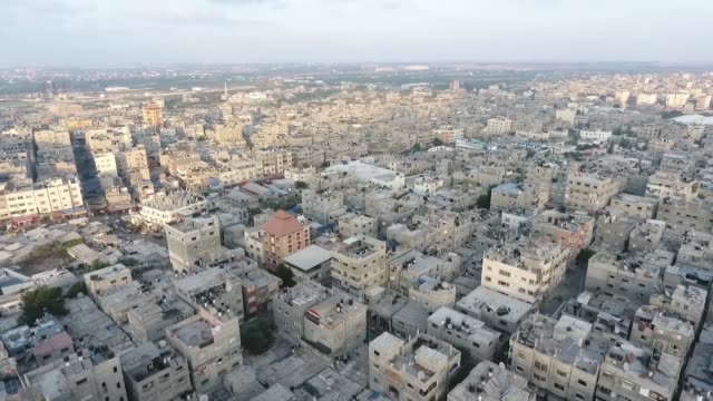 drone shot of concrete buildings and city architecture in gaza palestine - gaza strip stock videos & royalty-free footage
