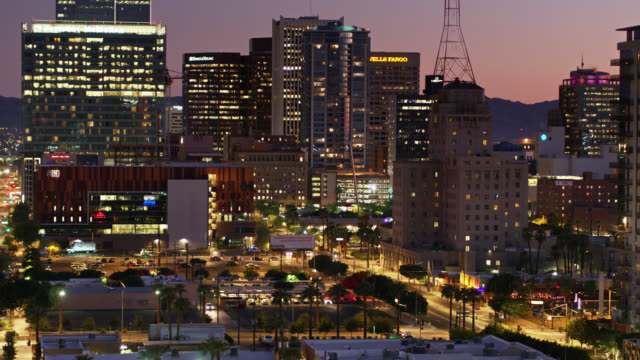 drone shot of downtown phoenix at twilight - phoenix arizona stock videos & royalty-free footage
