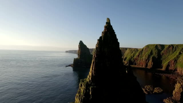 Drone shot of dramatic sea stacks at Duncansby Head near John O' Groats in Scotland