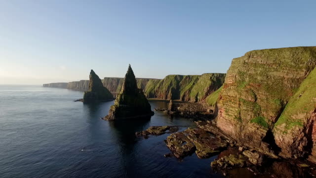 drone shot of dramatic sea stacks at duncansby head near john o' groats in scotland - dramatic landscape stock videos and b-roll footage
