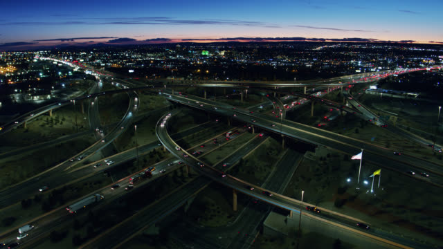 drone shot of evening freeway traffic in albuquerque at sunset - new mexico stock videos & royalty-free footage