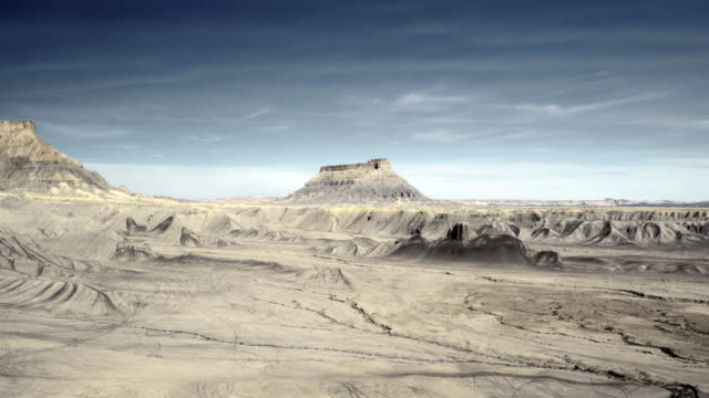 drone shot of factory butte and surrounding desert - butte rocky outcrop stock videos and b-roll footage