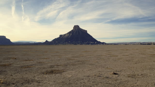 drone shot of factory butte - butte rocky outcrop stock videos and b-roll footage