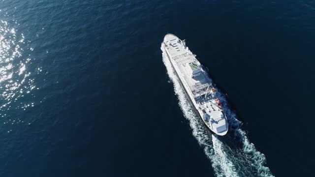 drone shot of ferry leaving port in lofoten archipelago - ferry stock videos & royalty-free footage
