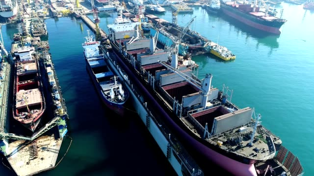 drone shot of freight ship maintenance - industrial ship stock videos & royalty-free footage