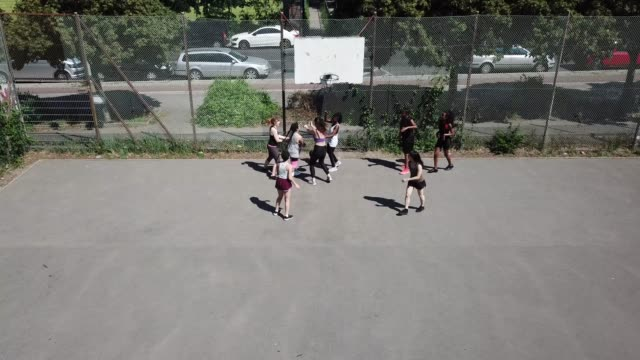 drone shot of friends playing basketball - sports court stock videos & royalty-free footage