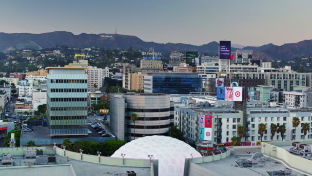 drone shot of hollywood at sunset - cinerama dome hollywood stock videos & royalty-free footage
