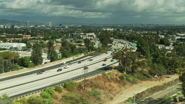 drone shot of i-10 panning to reveal downtown culver city - interstate 10 stock videos & royalty-free footage