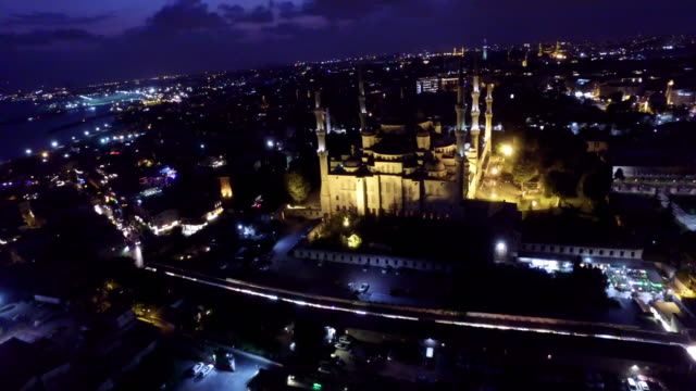 Drone shot of illuminated Blue Mosque and cityscape at night