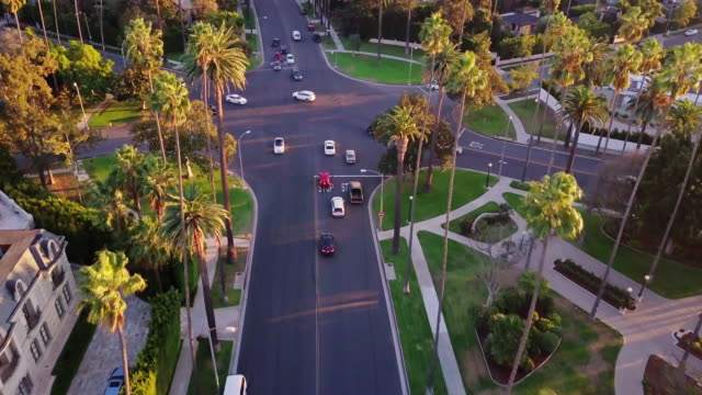 drone shot of intersection in centre of beverly hills - urban road stock videos & royalty-free footage