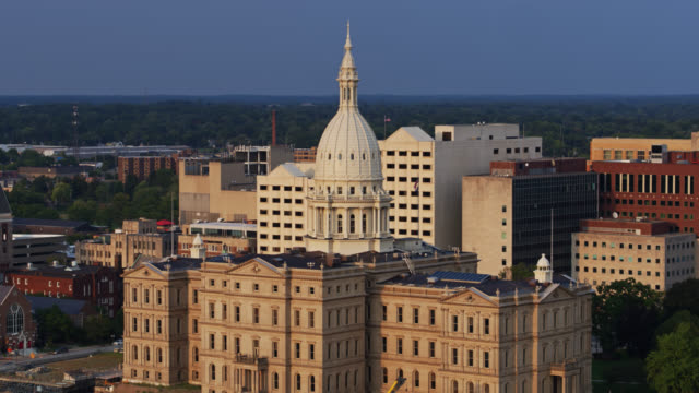 drone shot of michigan state capitol revealing excavations for heritage hall - michigan stock videos & royalty-free footage