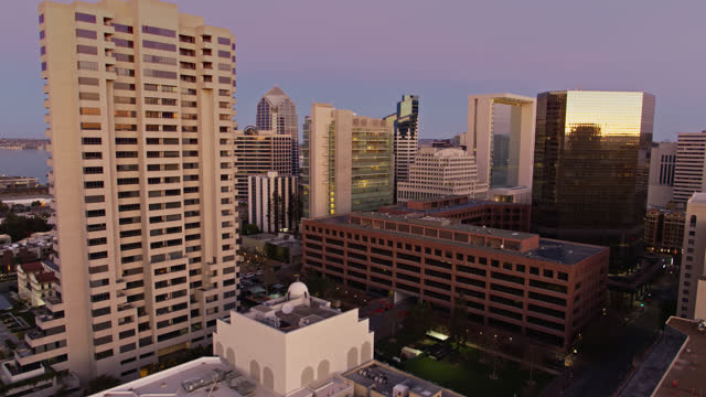 drone shot of modern buildings in downtown san diego before sunrise - san diego stock videos & royalty-free footage