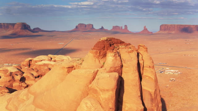 drone shot of monument valley from behind a ridge - navajo reservation stock videos and b-roll footage