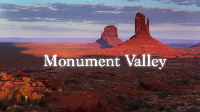 drone shot of monument valley with overlaid text - navajo reservation stock videos and b-roll footage