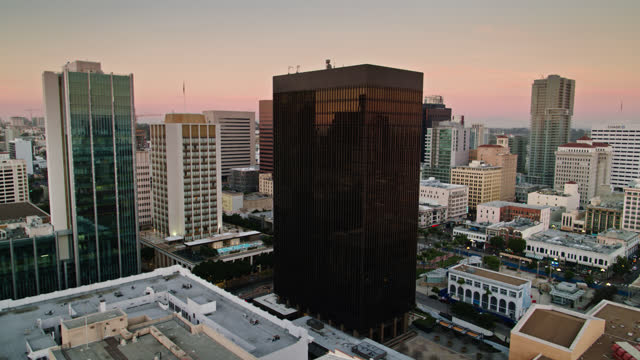 drone shot of office buildings in downtown san diego at dusk - san diego stock videos & royalty-free footage