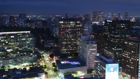 drone shot of office towers in westwood, los angeles at night - westwood neighborhood los angeles stock videos & royalty-free footage