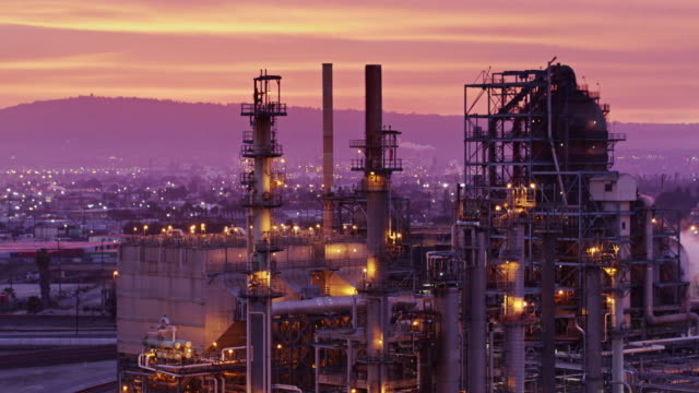 drone shot of oil refinery at sunset - oil industry stock videos & royalty-free footage