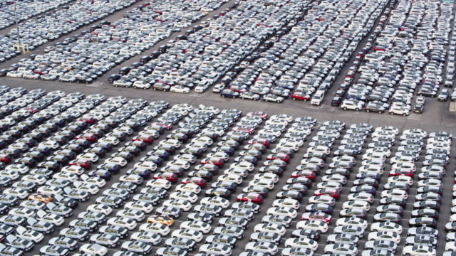 drone shot of port of la, sweeping down over yard full of new cars - automobile industry stock videos & royalty-free footage