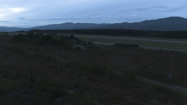 drone shot of remote airstrip in the norwegian woods in the morning - airport runway stock videos & royalty-free footage