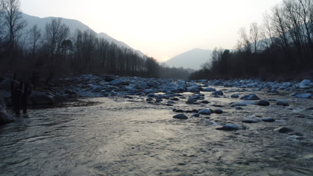 drone shot of river at sunset - ticino canton stock videos and b-roll footage