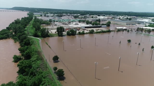 stockvideo's en b-roll-footage met drone shot of severe flooding along the arkansas river in tulsa oklahoma - environment or natural disaster or climate change or earthquake or hurricane or extreme weather or oil spill or volcano or tornado or flooding