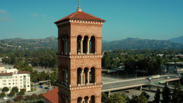 drone shot of st. andrews catholic church, pasadena california - steeple stock videos & royalty-free footage