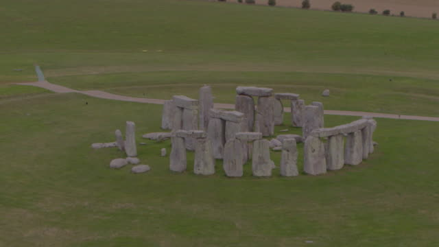 drone shot of stonehenge with the camera moving away from the center of the site on august 29 2018 in wiltshire england - aerial or drone pov or scenics or nature or cityscape stock videos & royalty-free footage
