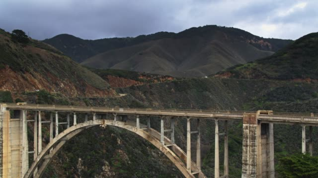 drone shot of support struts of bixby creek bridge - route 001 stock videos & royalty-free footage