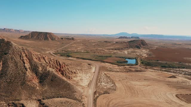 drone shot of the bardenas reales national park in spain - exploration stock videos & royalty-free footage
