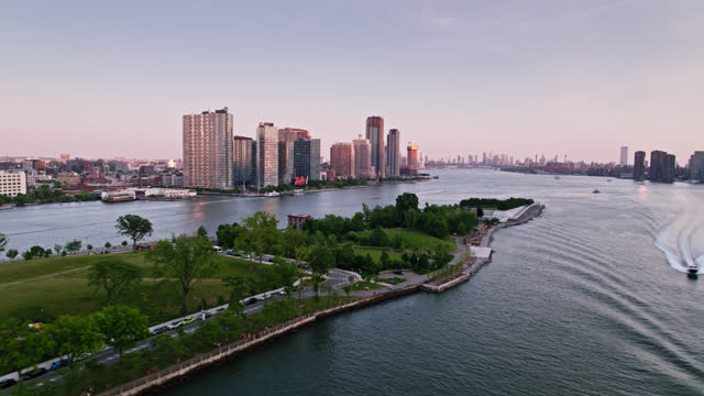 drone shot of the east river between queens and manhattan - queens new york city stock videos & royalty-free footage