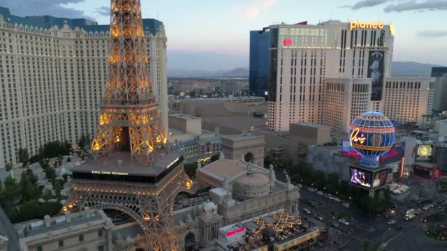 drone shot of the las vegas strip, showing paris vegas - tourism stock videos & royalty-free footage