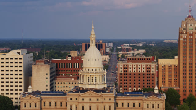 drone shot of the michigan state capitol building - lansing stock videos & royalty-free footage
