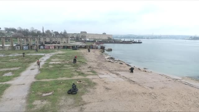 drone shot of the shore in sevastopol crimea being cleaned up from litter by volunteers - sevastopol crimea stock videos and b-roll footage