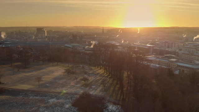 drone shot of the sun rising over brandon hill park & the city of bristol, england during a cold winter's morning - city stock videos & royalty-free footage