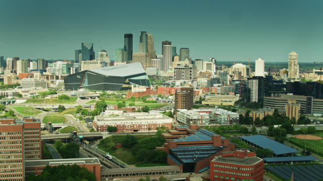 drone shot of the u.s. bank stadium and downtown minneapolis from over the university of minnesota - minnesota stock videos & royalty-free footage