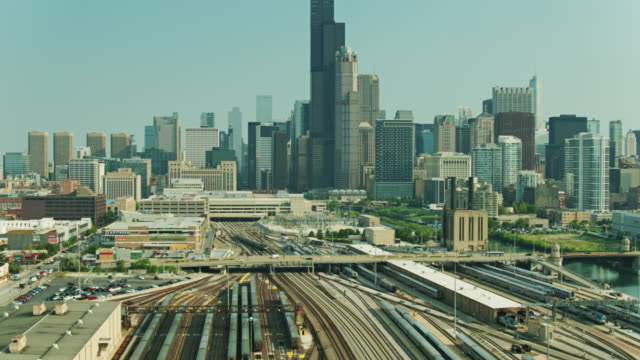 drone shot of train yard tilting up to show downtown chicago - willis tower stock videos & royalty-free footage