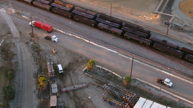 drone shot of white trucks in oil refinery - port of los angeles stock videos & royalty-free footage