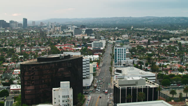 drone shot of wilshire boulevard in beverly hills, california - century city stock videos & royalty-free footage