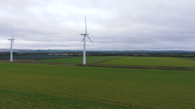 drone shot of wind turbines spinning - energy efficient stock videos & royalty-free footage