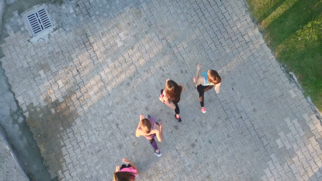 drone shot of young women jogging on walkway - pavimento video stock e b–roll