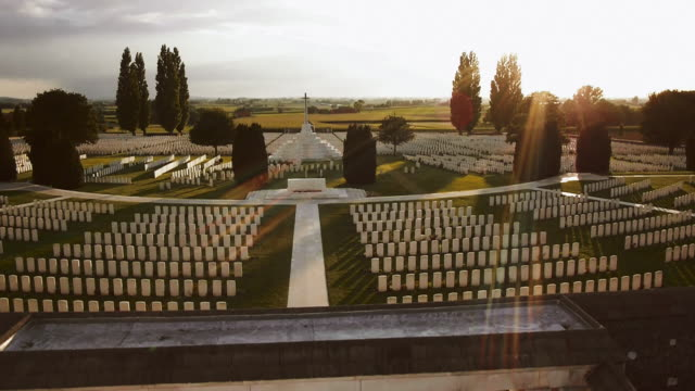 drone shot over the tyne cot war graves cemetery. - war stock videos and b-roll footage