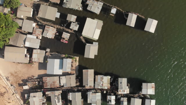 drone shot over water village in port moresby - economy stock videos & royalty-free footage