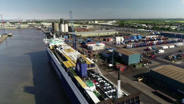 drone shot panning down at immingham docks - ship stock videos & royalty-free footage
