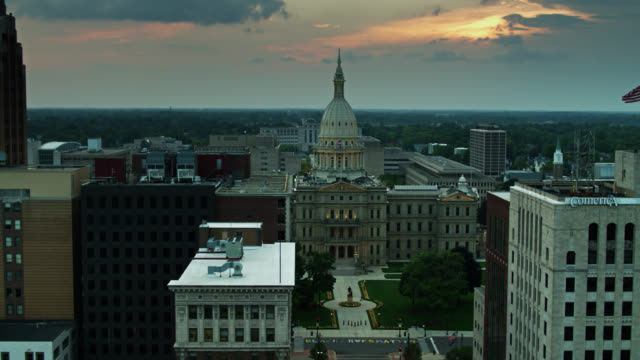 drone shot pulling away from michigan state capitol building - identity politics stock videos & royalty-free footage