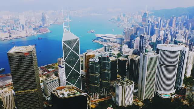 drone shot: real time ,  4k aerial view of hong kong skyline, china. - hong kong island stock videos & royalty-free footage