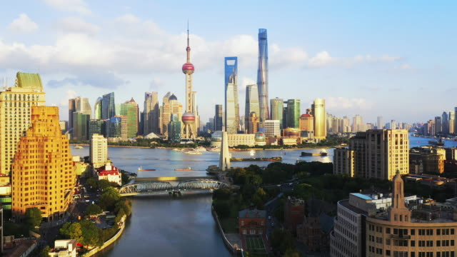 drone shot: real time ,moving up, 4k aerial view of shanghai skyline  at sunset, china. - china east asia stock videos & royalty-free footage